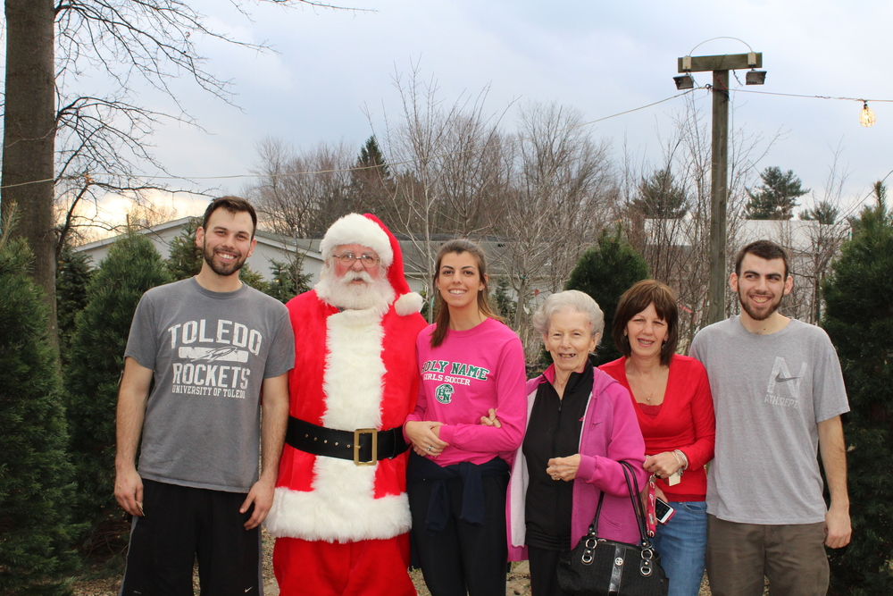 Picking out just the right Christmas tree was a family affair that included Santa!