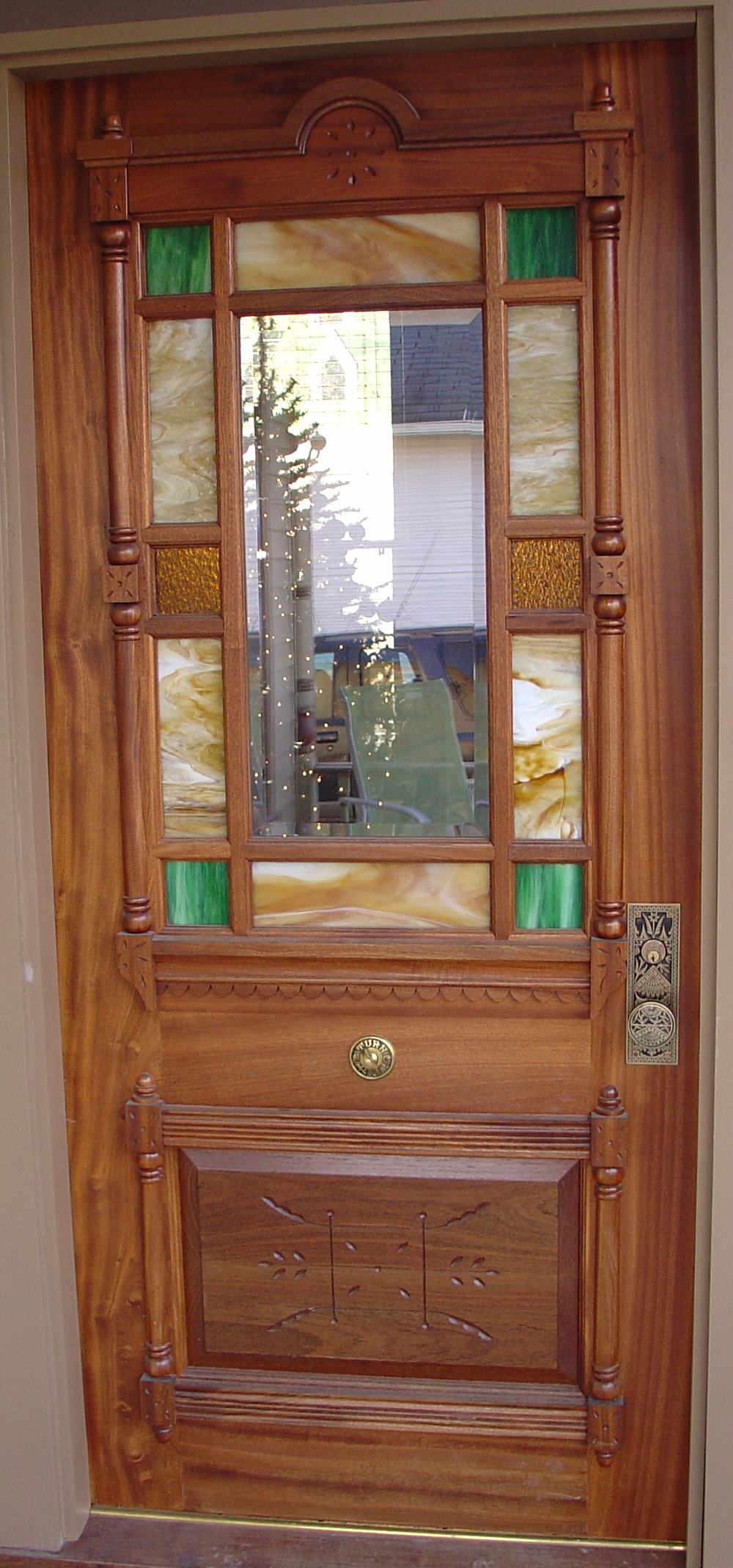 "Reproduction door.  2 1/4"" sapele with IG art glass and bevelled glass lites."