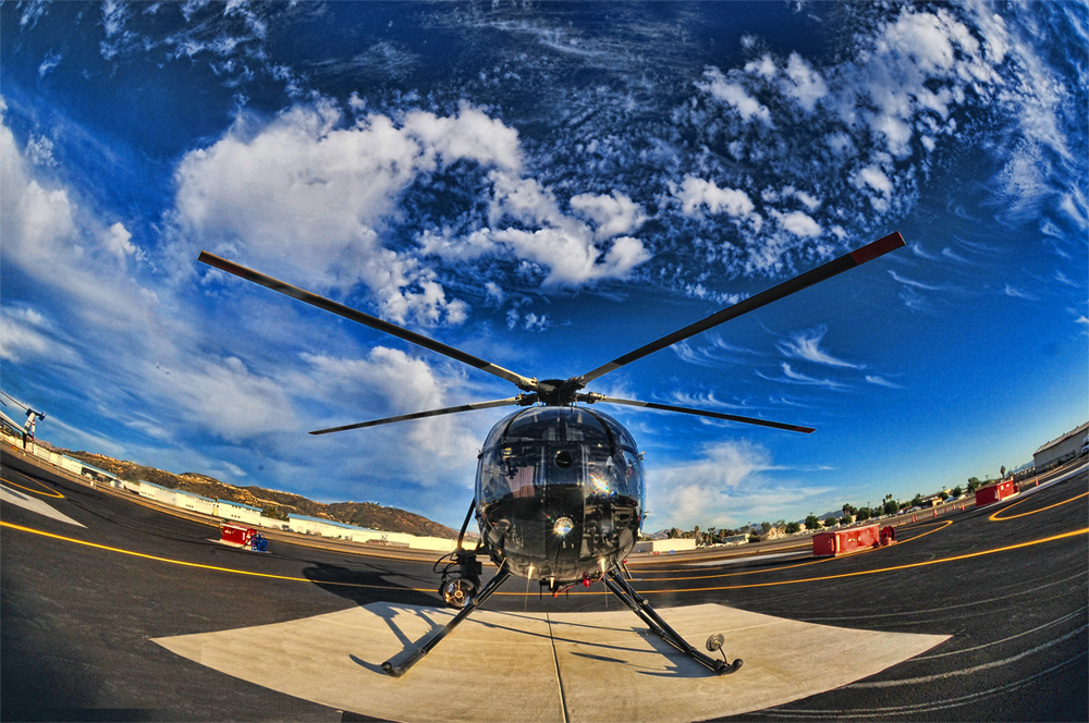 A San Diego Sheriff's MD500D Helicopter setting on the ASTREA ramp. Photo by Hans Kuwert.
