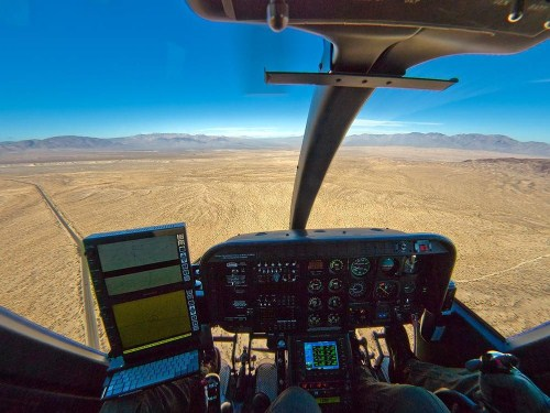 Cockpit of a Bell 407 on patrol. The pilot, on the right, would pick out his LZ and hold it somewhere in the center of his windscreen, above the panel.