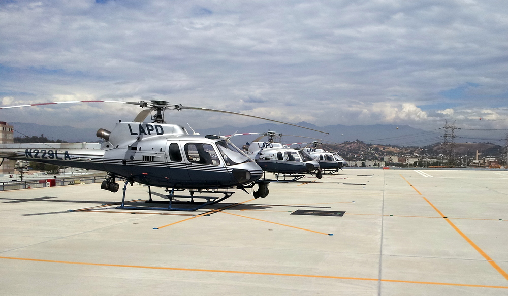 Three LAPD patrol helicopters waiting for action at the rooftop heli-port near Downtown L.A.