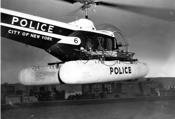 This early Bell 47 NYPD helicopter was outfitted with floats and a rescue basket to perform water rescues around the city.