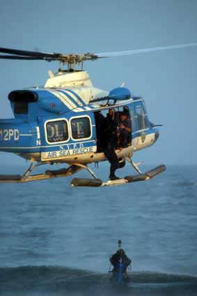 An NYPD Air Sea Rescue helicopter hoisting a diver out of the water on an actual water rescue.