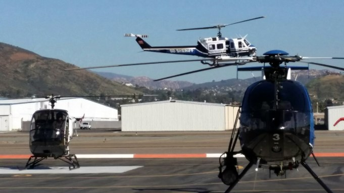 Schweizer (Sikorsky) 300 on the left, Bell 205 helicopter top center, MD530F Helicopter on the right.