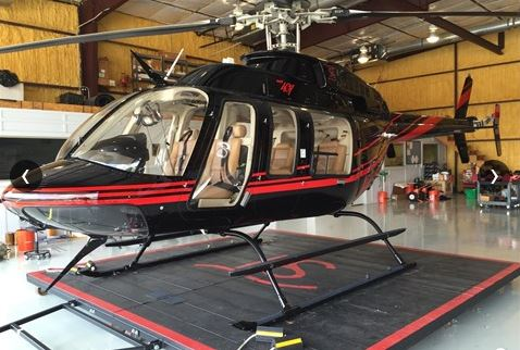This Bell 407 makes a beautiful corporate helicopter that can carry 2 pilots and 5 rear passengers