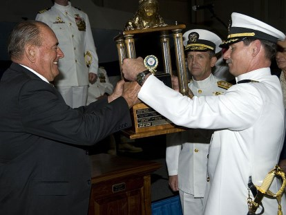 "Admiral Richard ""Dick"" Lyon passing the Bull Frog Trophy to Capt. Pete Wikul. Wikipedia photo."