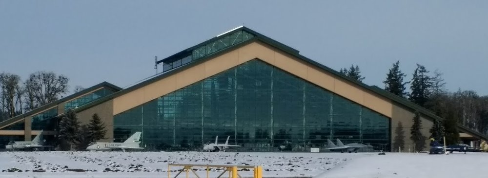 Jerry Trimble Helicopters is located directly across the street from the Evergreen Aviation Museum - home of the Spruce Goose which is just barely discernible behind this wall of glass.