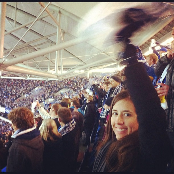 That is Amanda Skerski waving a scarf at a soccer game. Naturally, she's holding a cigarette in that same hand and a beer in the other. And she just completed some chant about knowing where the ref has parked his car and that she is going to burn it down after the game. Europe does strange things to people.
