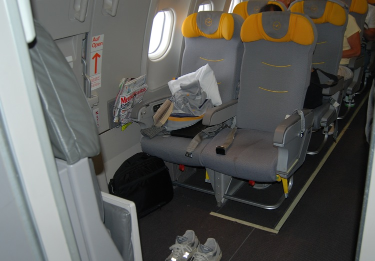 "Lots of space As I am typing this blog entry, I am arguably sitting on the best flight ever – flying from Portland direct to Frankfurt on Lufthansa. Since Lufthansa is a German company, there might be a slight bias in play here but that's ok.  I am constantly flying for work, and other than flying on a private jet, this has been the best flight experience in a long time. It's refreshing to see an airline do some things right, especially from the perspective of a guy who publishes a book on how to write complaint letters. Here's what Lufthansa did right today: When checking in at the gate, there counter was well staffed and we got checked in to our flight within a matter of 5 minutes. This is unusually fast for an international flight. At the counter, I asked if there was any chance that Jen and I could get a window/aisle seat rather than the ""bathroom watch"" row we were assigned in the back of the plane. The guy told me that he wasn't able to make any changes right now, but to find him once we got to the counter. I, of course, forgot to find him at the counter. Instead, he found me. While walking on to the airplane, he pulled us aside (I was assuming they had opened my luggage and were wondering why I was bringing 37 brand new soccer jerseys) and asked whether we'd still like to change seats.  2 minutes later, we had graduated from the bathroom watch row and were sitting in a window/isle in an exit row. As you can see in the picture above, the leg room was incredible. Before walking onto the plane, we grabbed a half dozen magazines (GQ, Mens Health, Cosmopolitan, Nudists News) from their free magazine counter and boarded the plane. Once on the plane, we enjoyed excellent food, great service and lots of sleep induced by French wine and a couple of blue pills – the sleeping kind. Lufthansa really didn't do anything crazy here, but unlike most airlines, they upheld the promise of the kind of service that one should be able to expect. Nothing crazy, just basic stuff. Now, some might say that international flights are always more pleasant than domestic ones. But I disagree. I paid $900 a piece for this tickets, which isn't that much more than a number of domestic routes are going for these days. Anyways, we are about to land in Frankfurt. Who knows what will go wrong there, but this is was an awesome flight. Thank you Lufthansa. Ps. It should be noted that the on-board entertainment was broken for the duration of the flight, as the system's hard drive somehow got corrupted. While this was certainly a bummer, I won't remember it as a negative. Rather than keeping us in the airport for hours and hours, the captain made the right choice in departing Portland rather than trying to fix a problem that wouldn't have been fixed anyways."