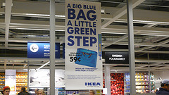 big blue for a little green  I went to Ikea the other day to get a new bookshelf and some chocolate covered caramel candy, and was pleasantly surprised at checkout. Ikea is beginning to charge customers 5 cents for a plastic bag (59 cents buys you a re-usable bag.) Charging for bags in grocery stores is something that I grew up with in Europe, but probably seems really uncommon here in the US. Well, I think it's awesome that Ikea is starting to charge for plastic bags. Re-usable grocery bags are already popping up right and left, and once consumers get financially rewarded (or punished when not) for bringing their own bags, they will. I assume that Ikea is probably partially doing this, because green is cool right now. But that doesn't matter. The pay-for-your-grocery-bags trend is here to stay.