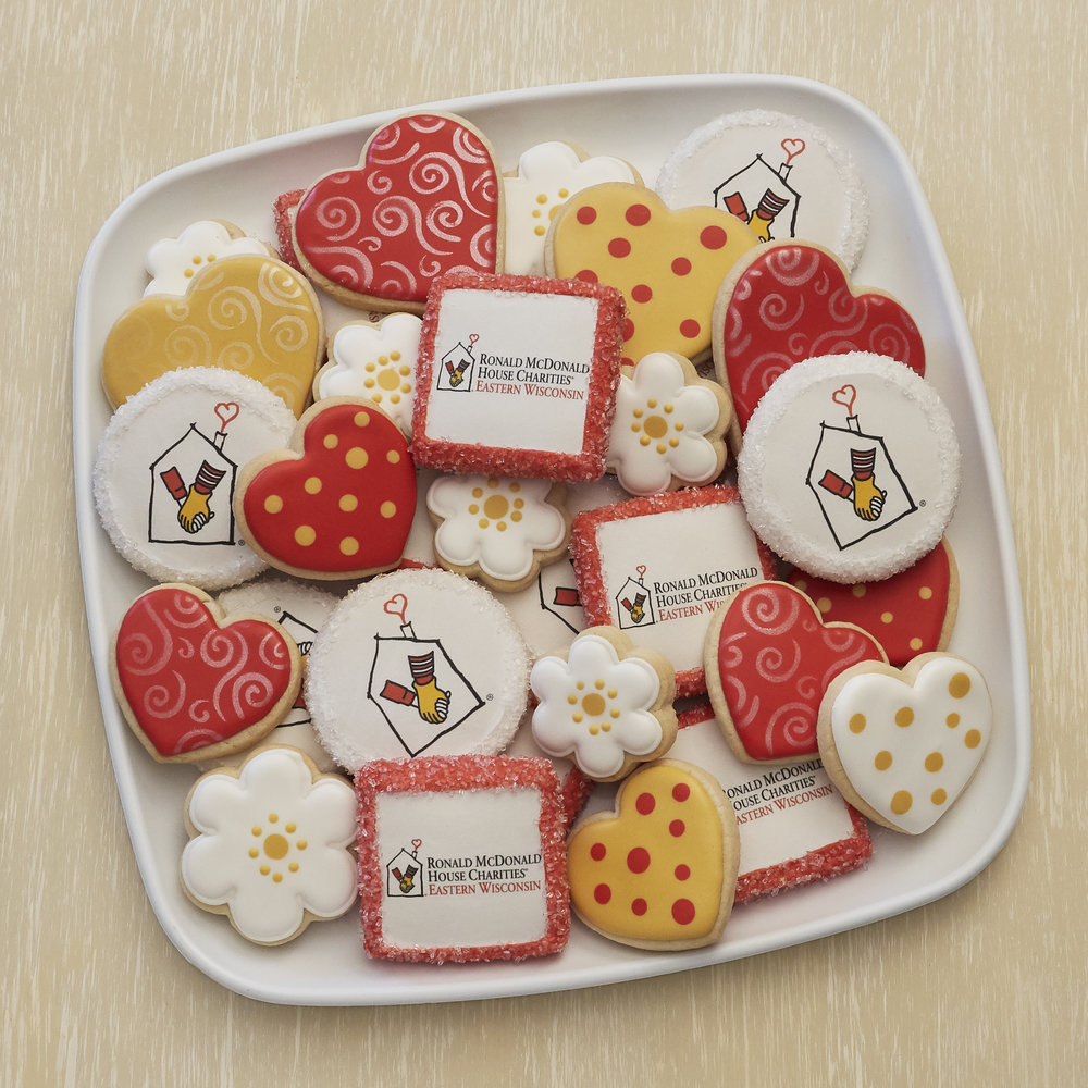 Ready to serve platter presentations of assorted sugar cookies showcasing your co. brand create a beautiful presentation for business gatherings, special events and holiday parties.