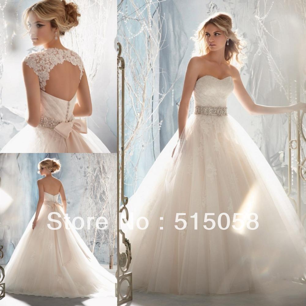 http://i00.i.aliimg.com/wsphoto/v0/1543321314_1/Removable-Lace-Jackets-Open-Back-Ivory-Tulle-Princess-Ball-Gown-Wedding-Dress-Bride-Vestidos-De-Novia.jpg