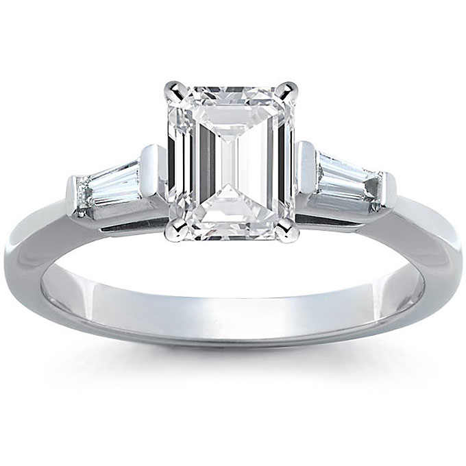 Platinum engagement ring with emerald-cut diamond center stone and tapered baguette diamonds, $1,800 (without center stone),Blue Nile
