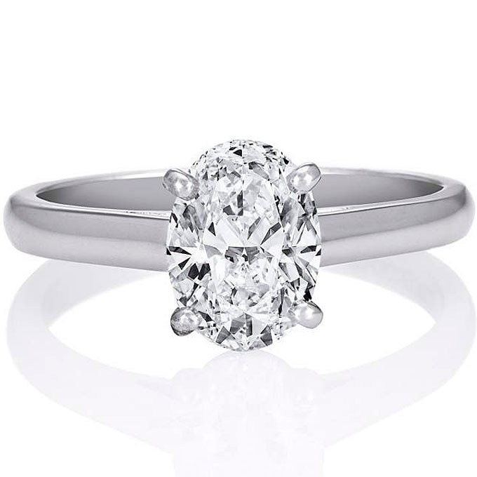 Platinum Classic Solitaire engagement ring with oval-cut diamond center stone, price upon request,De Beers
