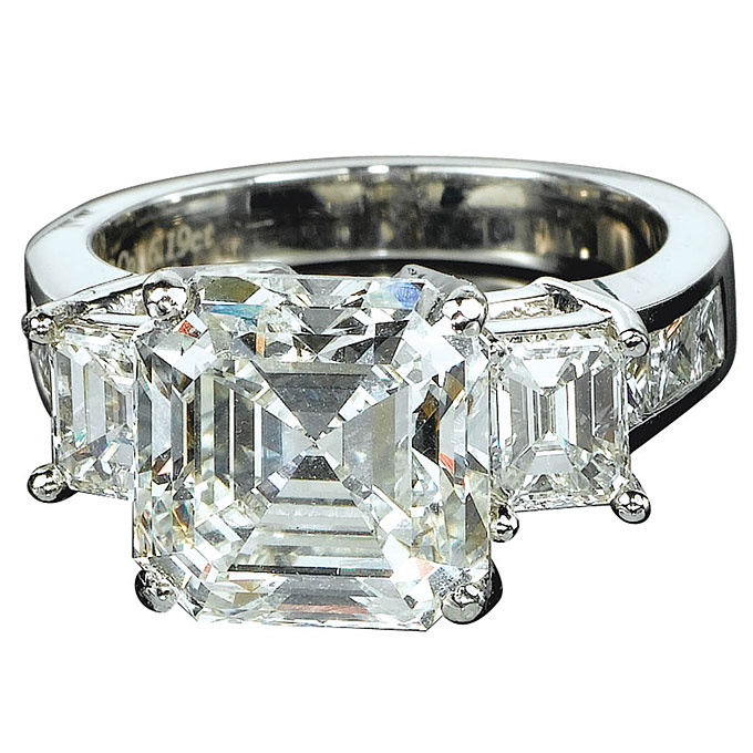 Platinum engagement ring with emerald-cut diamond center stone and side stones, $8,350 (without center stone),Jacob & Co