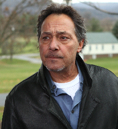 Dick (Bob Romanus)  is part of UOPS. Unusual Occurrence and Paranormal Society.  NY state chapter.  Dick is here with his wife Dot, to investigate a report of UFO activity in the South Mountain area.  He is staying at the Penn National Inn and Golf Club on 997.  (Route 30, Mojave Phone Booth, Fast Times At Ridgemont High)
