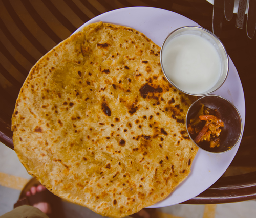 Paranthas (stuffed flat bread) with curd and pickle - our Indian breakfast