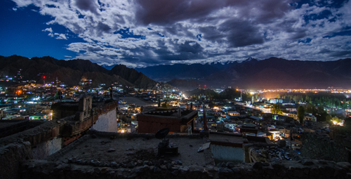 The roof tops of Old Town and lights of Leh at night