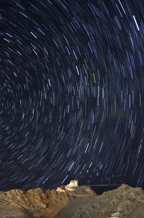 Star trails behind Tsemo Gompa