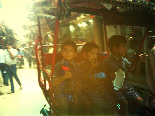 School kiddies in a cycle rickshaw