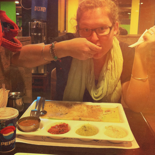 Mikayla really enjoying her dosa!