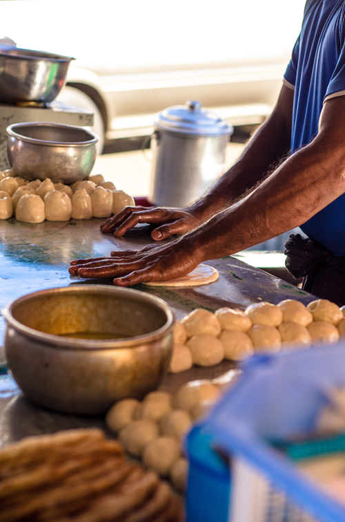 Man making chapatis.