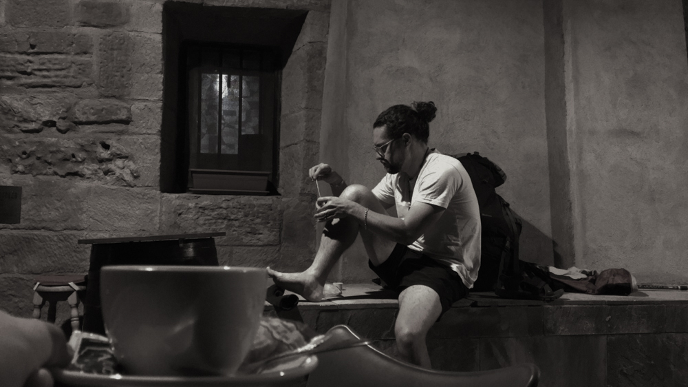 Ben wrapping his toes in the morning before leaving Navarrete - day 10