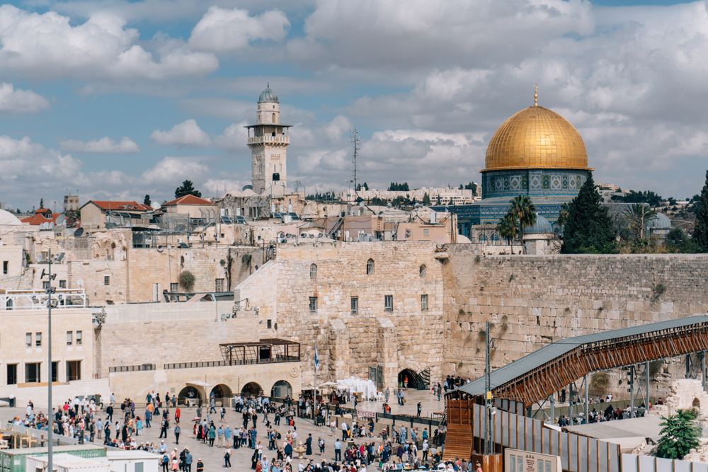 The Western Wall surrounding Temple Mount and the golden Dome of the Rock