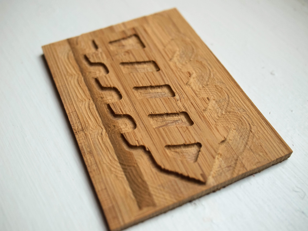 Bamboo plywood cut with a Shapeoko CNC mill, to be used for block printing.