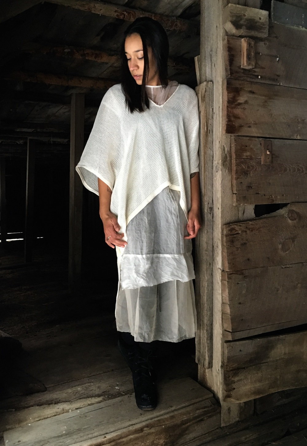 Twisted linen poncho of Maharam fabric. two available. 400.