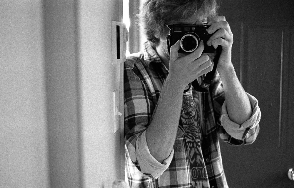 Selfie with said Leica. All pictures in this post were shot on film with it.