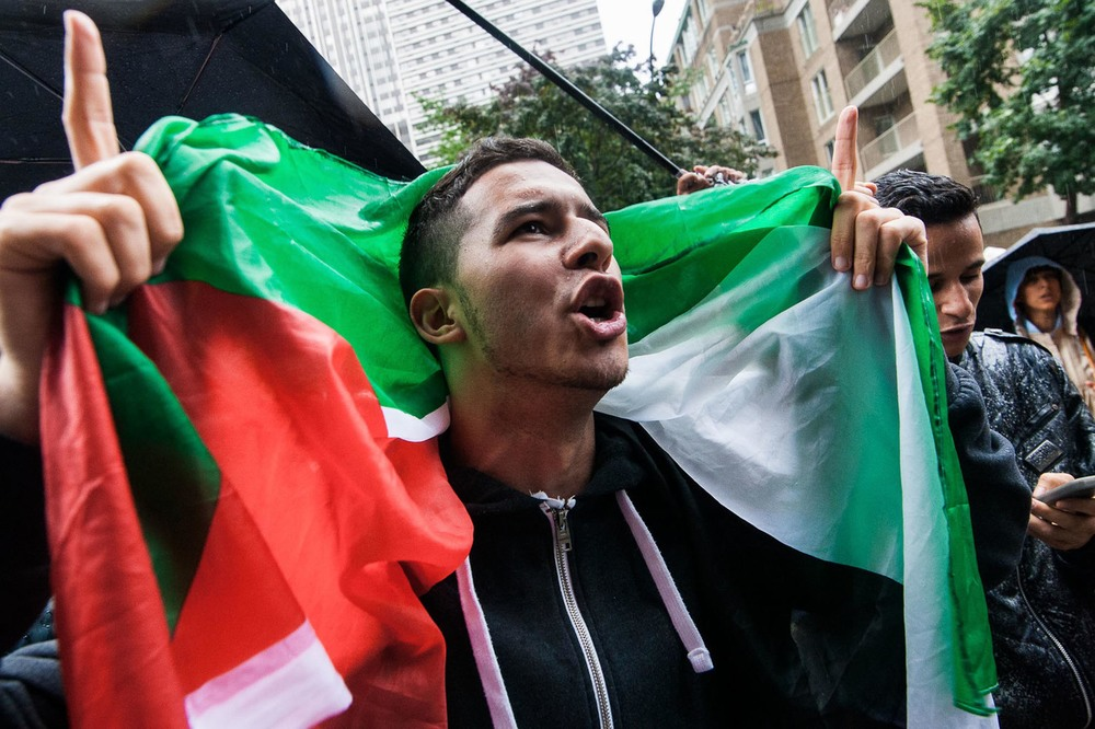 07/28/2014 Pro-Palestinian demonstration on Israel's Consulate doorstep in Montreal against  Op. Protective Edge . Palestinian officials claim over 1500 civilians were killed by Israel's offensive on the Gaza Strip.