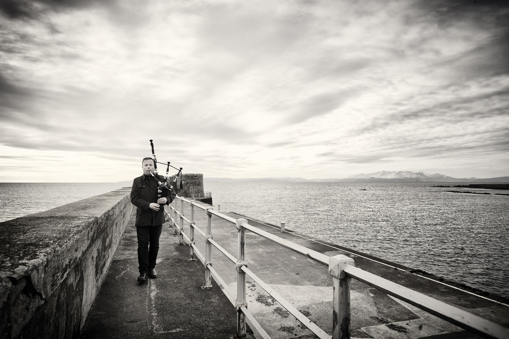 Mike Grey at Saltcoats harbour with Arran in the background