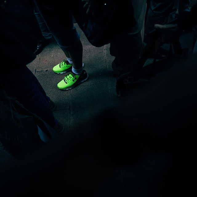 get your kicks #kicks #luckyshot #streetphotography #sneakers #dark #neongreen #underarmour