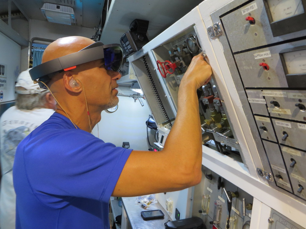 Astronaut Luca Parmitano using HoloLens during a complicated maintenance task in the Aquarius Reef Base, about 3 miles off the cost of Florida and 60 feet underwater.