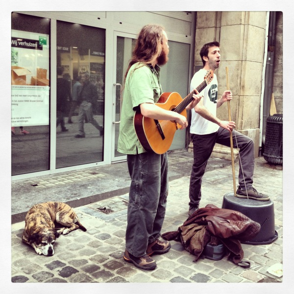 Street performers and their pup in Brussels.