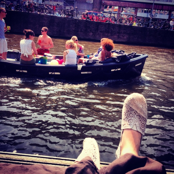 Taking a break along the canal after getting lost in Amsterdam!
