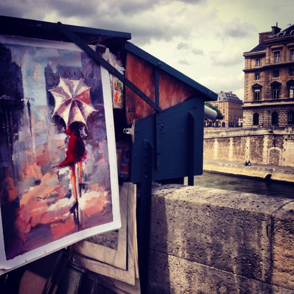 Along the Seine River in Paris, artwork for sale.