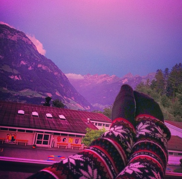 Cozied up on our balcony in Switzerland!