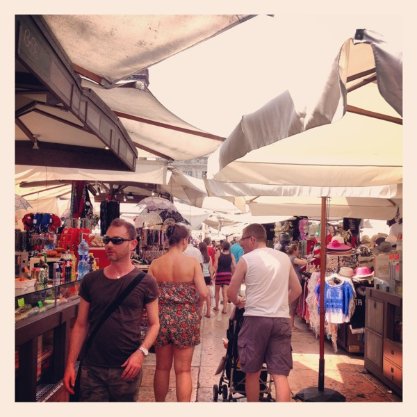 Hiding from the heat under the big canopy umbrellas!