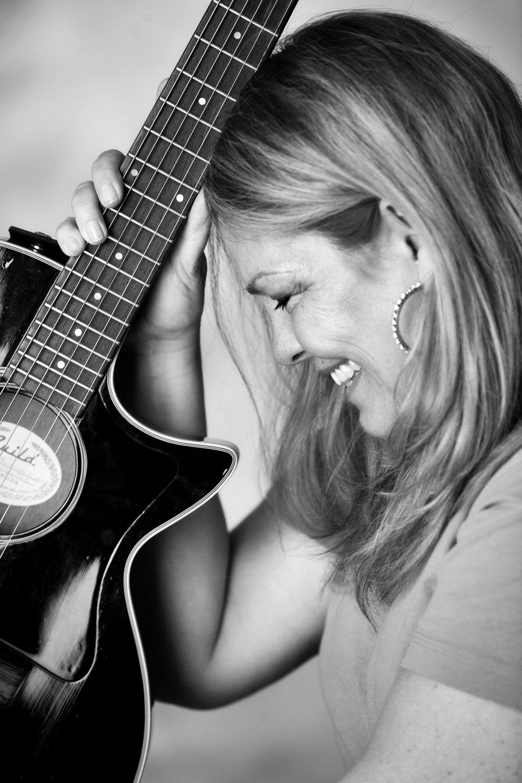Leanna Profile B&W with Guitar.jpg