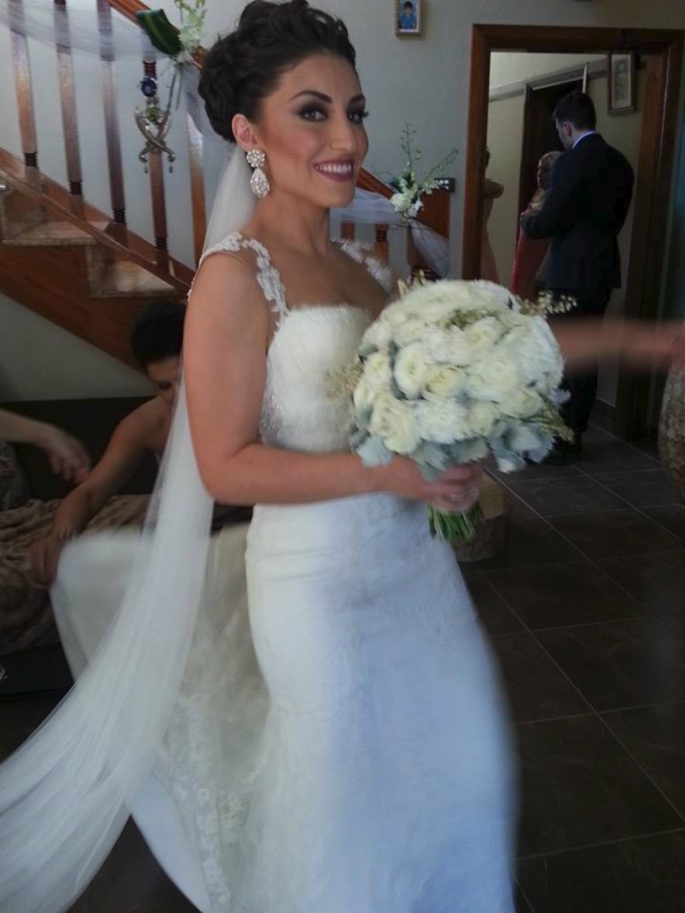 Nahida wears a custom-designed pair of Edera Jewelry earrings on her wedding day.