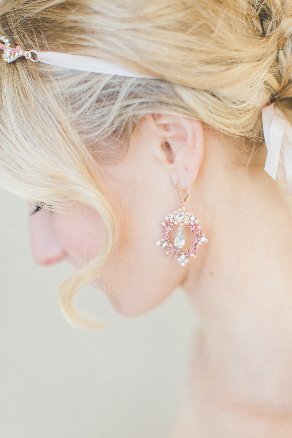 rose gold wedding earrings and hair vine