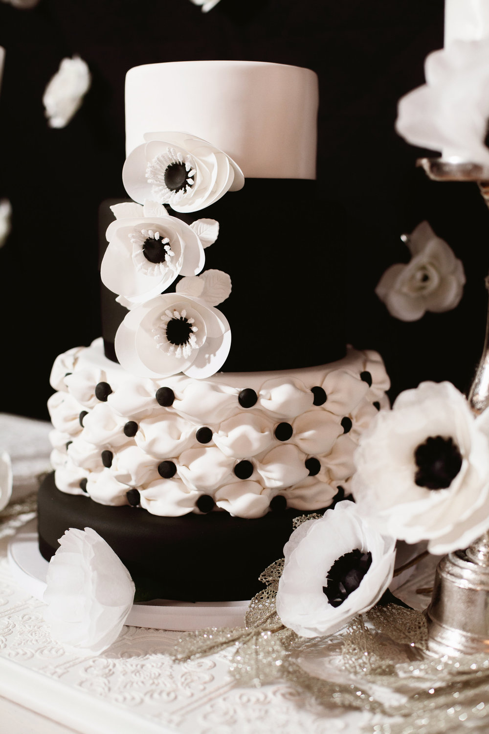 black and white wedding cake with anemones