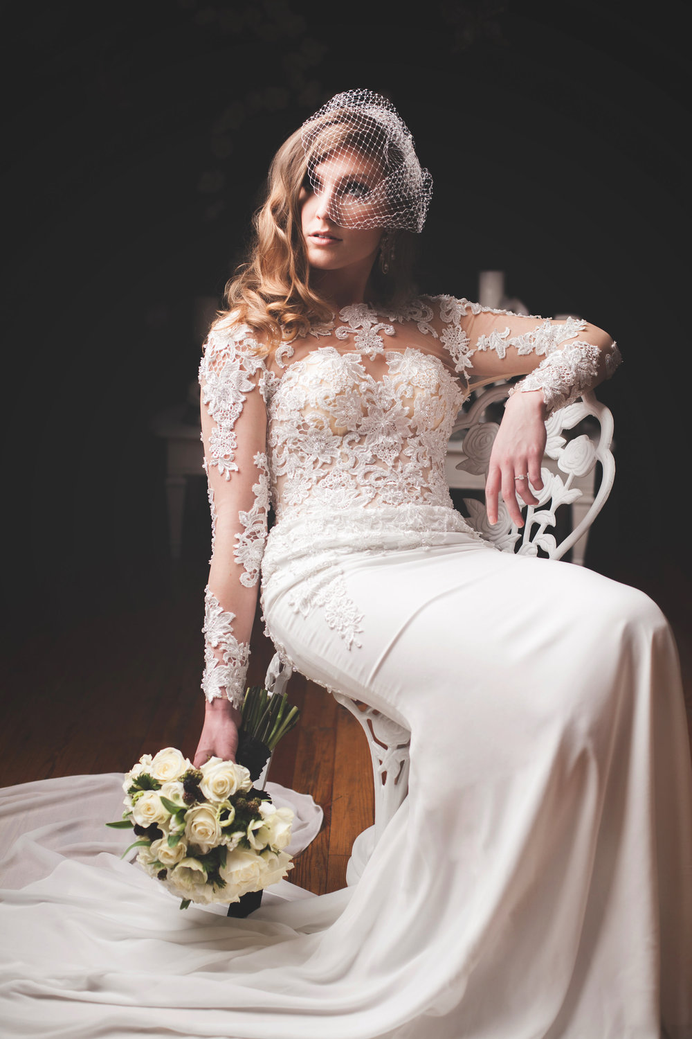 White lace long sleeved wedding gown