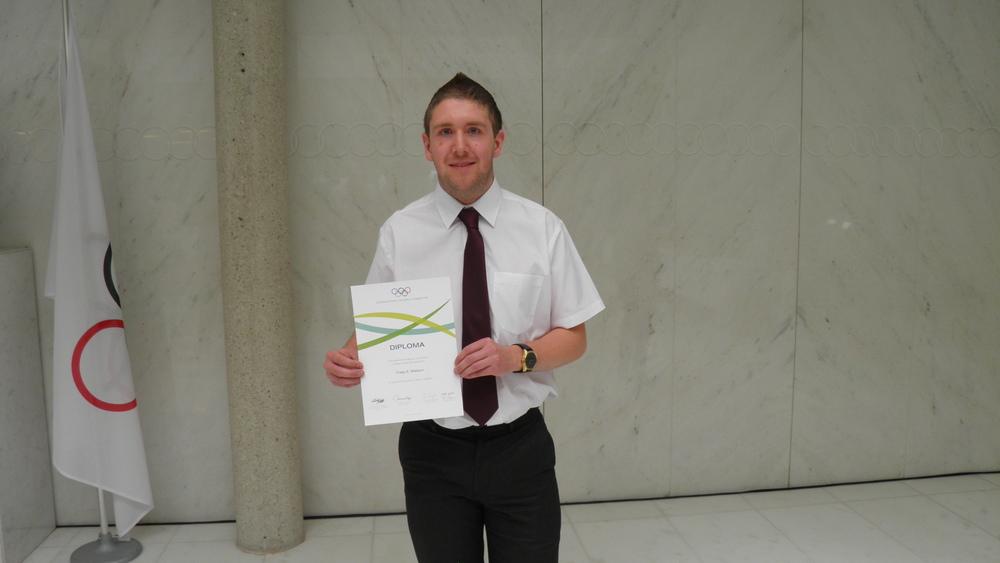Craig with IOC Diploma.JPG