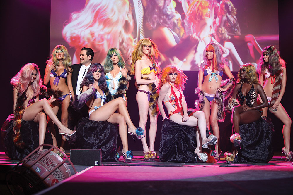 During the avant-garde runway show, even the model's shoes donned colored hair wigs.