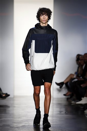 TIM COPPENS | NYFW | SS2015 | AP  The Tim Coppens Spring 2015 collection is modeled during Fashion Week, Sunday, Sept. 7, 2014, in New York. (AP Photo/Jason DeCrow)  Key Hair: Yannick D'IS. Hair: Oribe Hair Care Team, Kien Hoang for Oribe Hair Care. Nathan Nguyen | Umbrella Salon