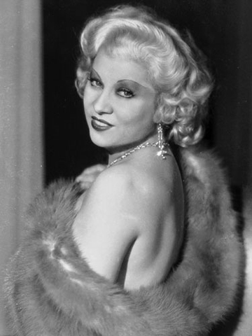 """Mae West (1930s)   """"She redefined the early century 'Hollywood Blonde' because she wasn't an innocent, doe-eyed ingénue. She was bold and sexy with the gift of incredible comic timing. Her platinum tresses only emphasized this rare and powerful combination."""" – Adam Livermore for Oribe Hair Care"""