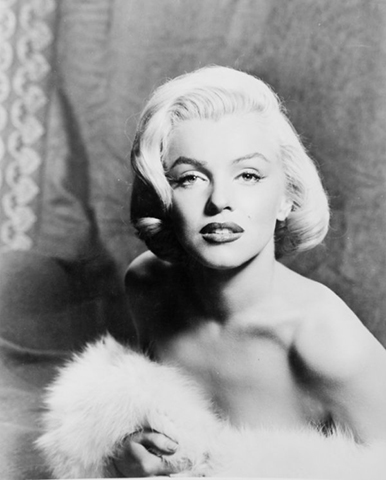 """Marilyn Monroe (1950s)   """"Marilyn was the epitome of the blondes. Her ash blonde was stunning and had shine and sex appeal. I loved that she had short hair and didn't wear a part. Whether it was combed out or a bouffant, her hair was set in ways that were just perfect for her.""""– Christian Ceja-Compin for Oribe Hair Care"""